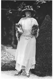 Edith Wharton carries her dogs